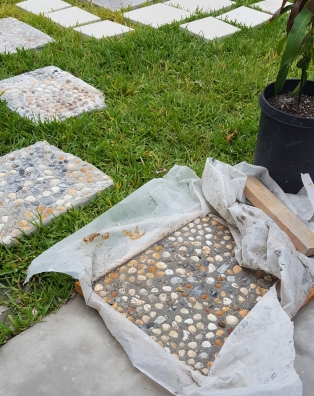 Mosaic stepping stones with seashells.